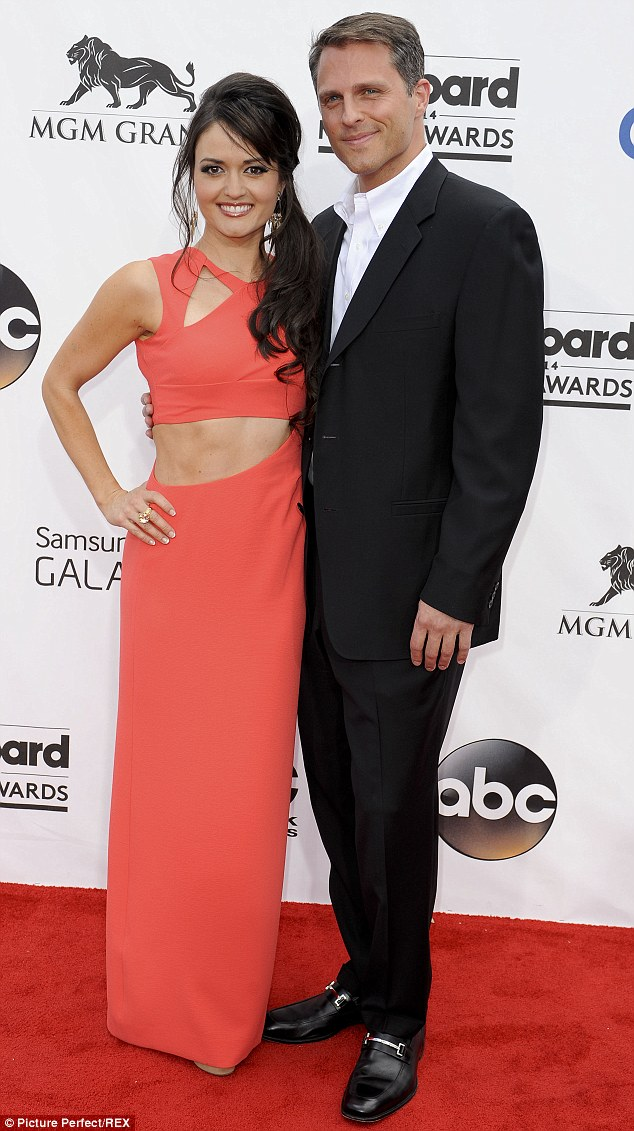 The lucky guy: McKellar with Scott at the Billboard Music Awards in May in Las Vegas