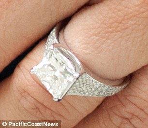 There it is: On her left hand was a stunning princess cut diamond set in white gold