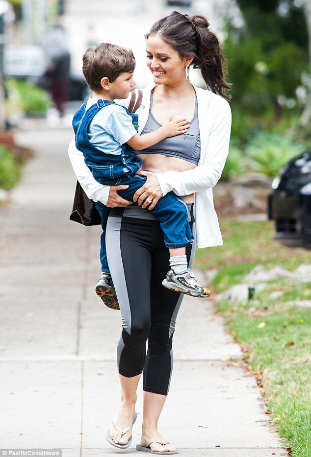 Doting mother: The star with her son Draco, aged three, in LA just hours after breaking the news of her engagement