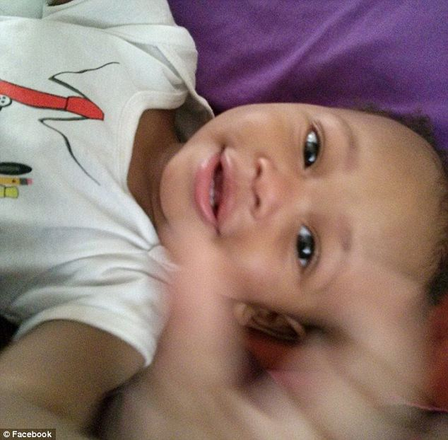 Horrific: 14-month-old Jaylen Harris allegedly died when the man watching him hugged him so heard he stopped breathing