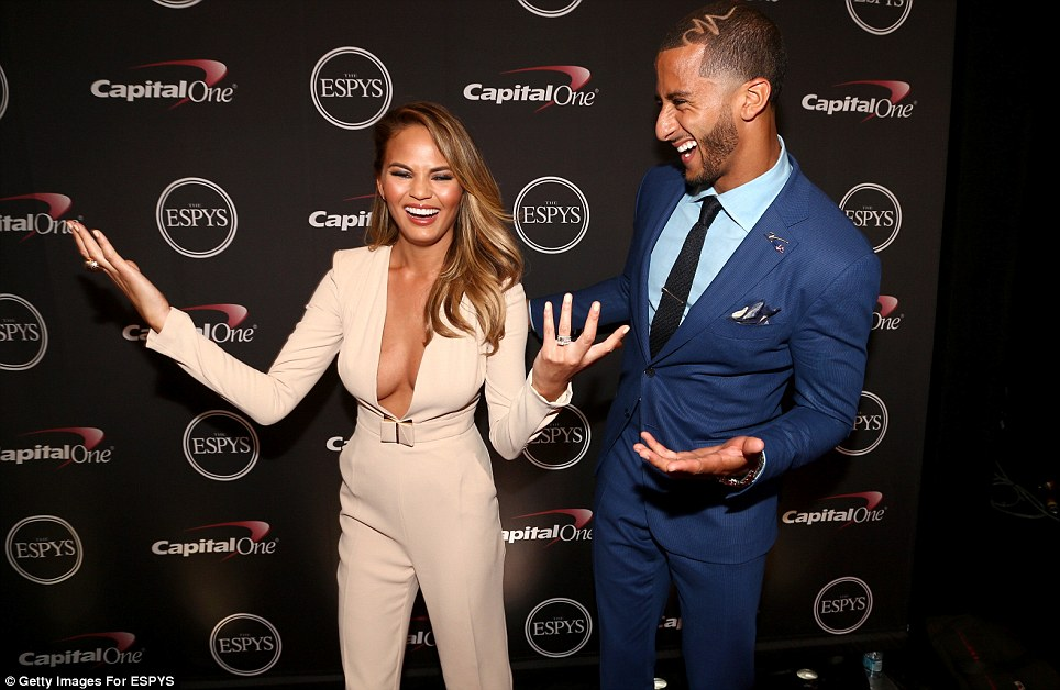 Larking about: Model Chrissy Teigen has a laugh with NFL quarterback Colin Kaepernick backstage at the LA awards