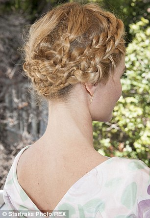 Intricate: Kate wore her blonde wavy hair in a complicated braided style