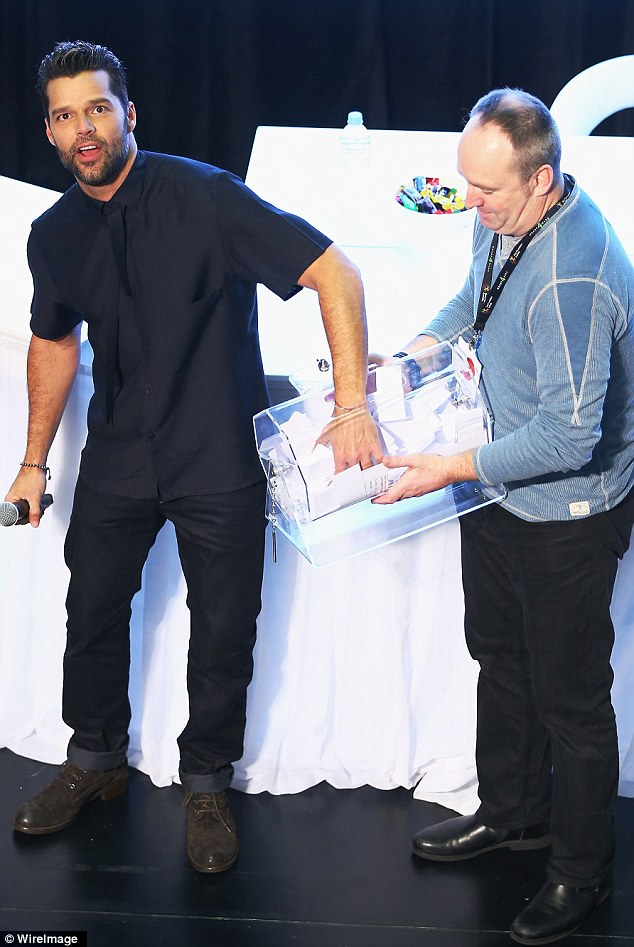 Barrel Boy: Ricky Martin took to the stage at a meet and greet with fans at Westfield Hurstville on Thursday evening and even took on barrel boy duties to pick a winning name out of the clear casing