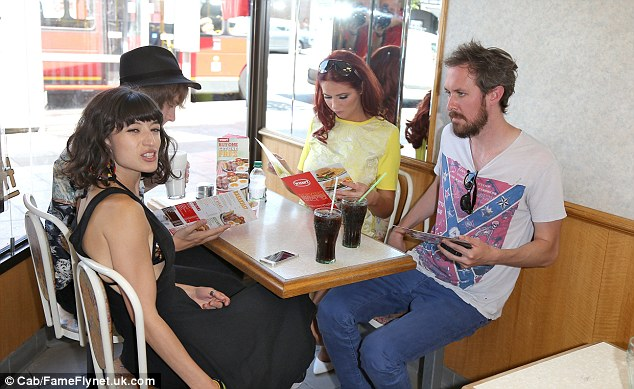 Tucking in: Amy was seen in Wimpy with her friends and her Fubar Radio co-host Joey Page (who sat opposite her)