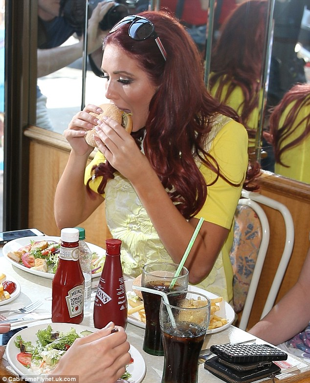 A mouth full: Amy was more than happy to try one of the burgers at the restaurant