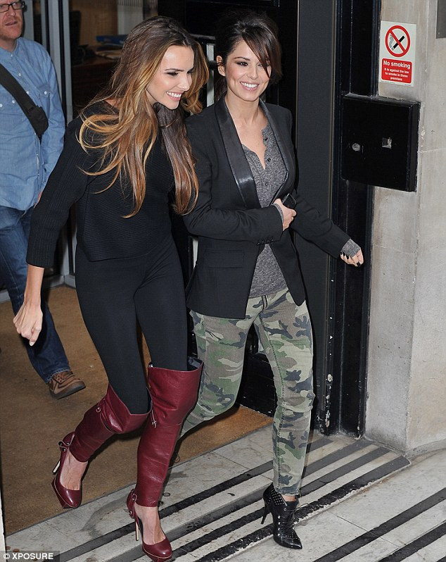 Arm in arm: Over the years Cheryl and Nadine's friendship has been rocked with rumours of rows
