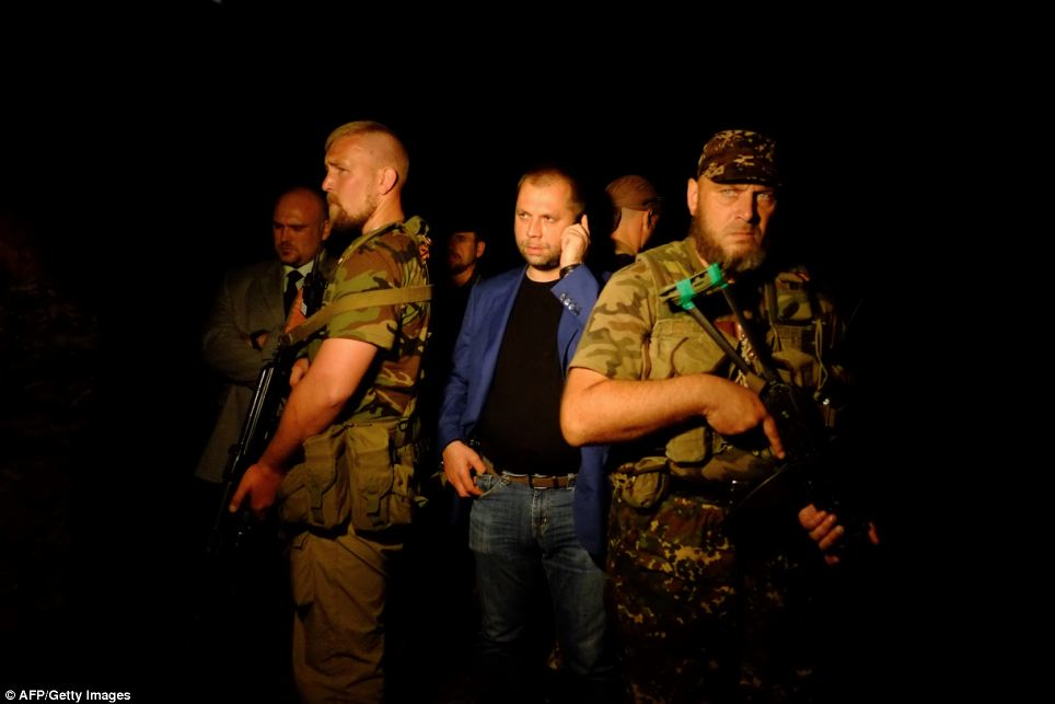 Arrival: The self-proclaimed Prime Minister of the pro-Russian separatist 'Donetsk People's Republic' Alexander Borodai (centre) arrives on the site of the crash