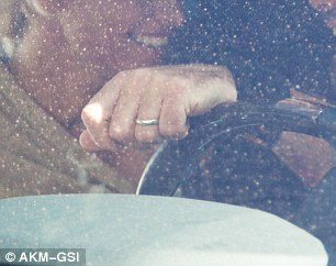The rings are back ON: The pinup had on her diamond (left) and he had on his gold band for the romantic get together