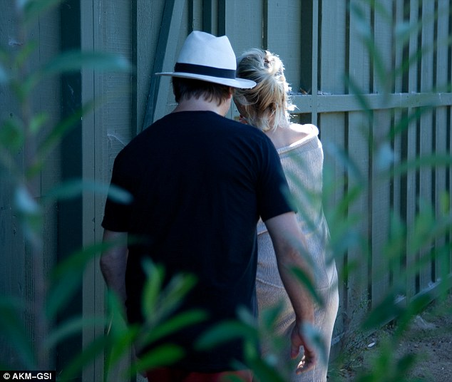 Back for good?: The on-again lovebirds headed into their Malibu residence after their PDA session