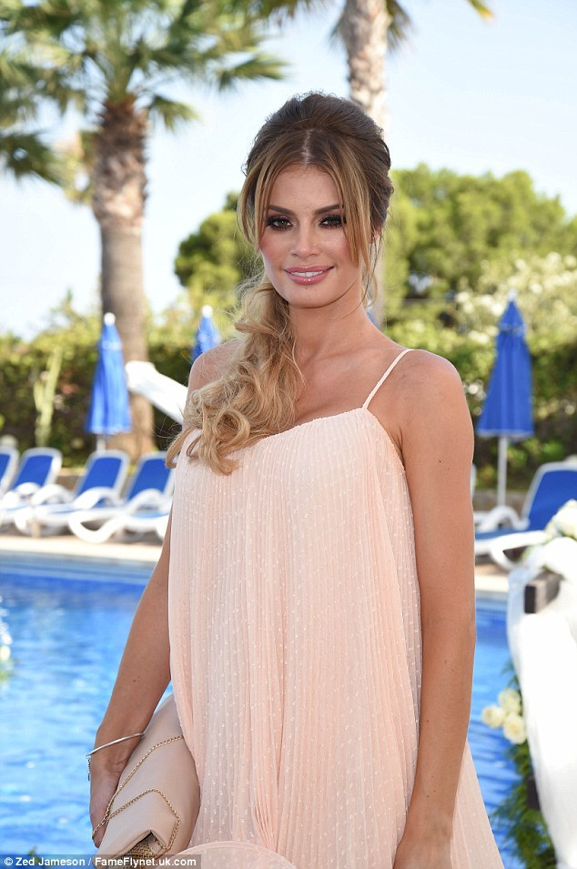 Glam girl: Chloe looked lovely in a peachy babydoll dress