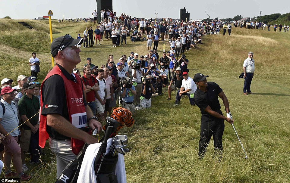 Getting out of the long stuff: Woods watches his shot from the rough on the tenth hole at Royal Liverpool Golf Course in Hoylake during his second round