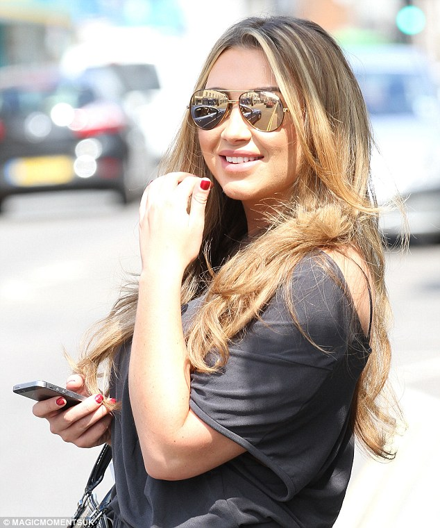 High spirits: The former TOWIE star greeted onlookers with a warm smile