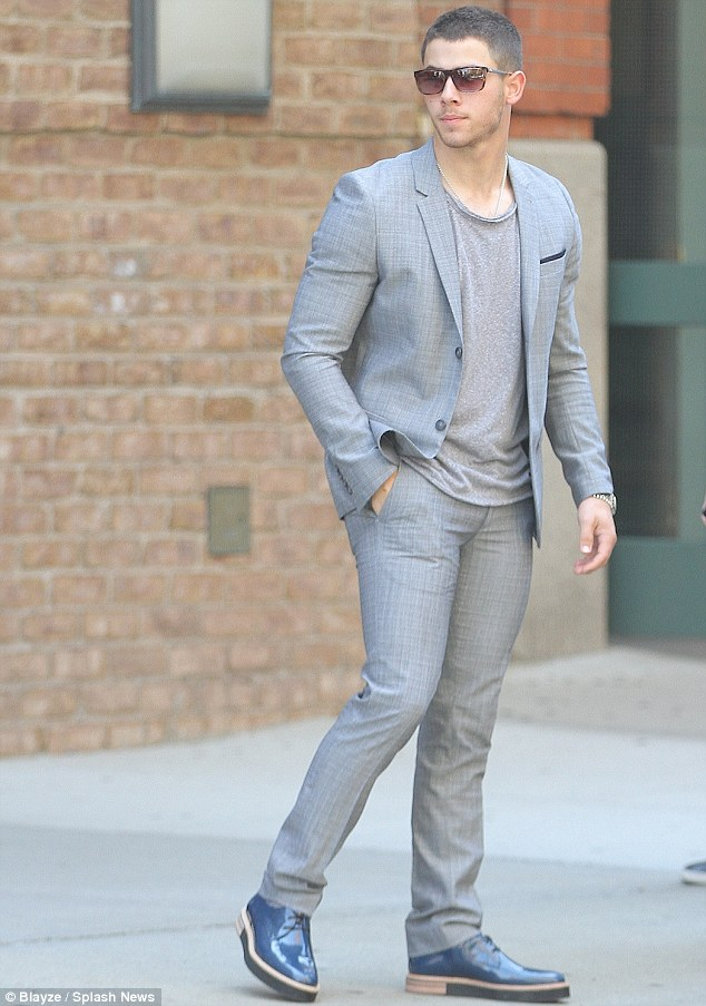 He's a Topman: Nick Jonas looked like a 90s menswear model in his grey suit in New York on Thursday
