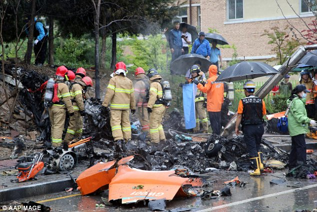 Wreckage: Tragically, all five firefighters inside the helicopter were killed in the crash