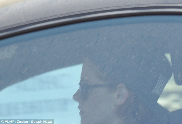 Dust in the wind: Kristen Stewart, 24, was spotted leaving the gym in Los Angeles in a rather dirty car