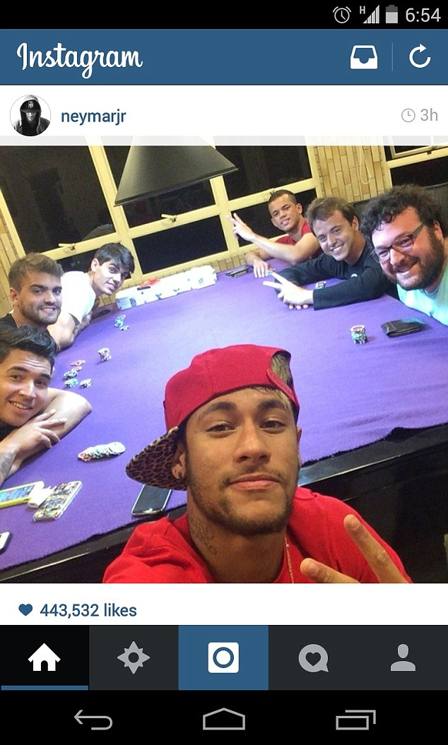 Selfie time: Neymar pictured with his friends playing a game of poker