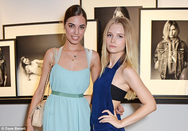 Fashion friends: Amber Le Bon (L) and Lottie Moss, who flashed some skin in her cutaway dress, attended the Calvin Klein Jeans x mytheresa party