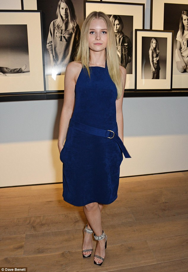 Seeing double: Lottie Moss attends the Calvin Klein Jeans x Mytheresa.com launch party and poses in front of her cool new shoot for the collaboration