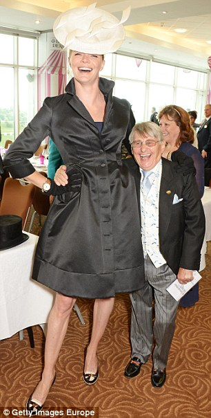 Glamorous: Racing fan Jodie pictured with jockey Willie Carson at the Investec Derby last month