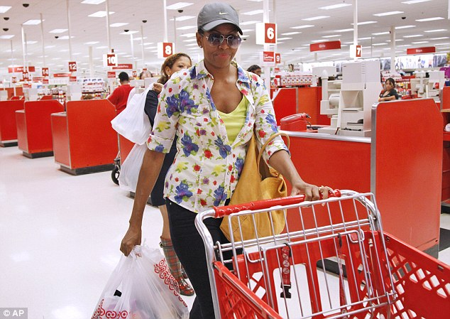 Talking carts: The USDA recently released a report this month which recommends grocery stores adopt new talking grocery carts that let shoppers know when they've purchased enough healthy foods. Above, healthy eating champion Michelle Obama pushing a cart at target in 2011