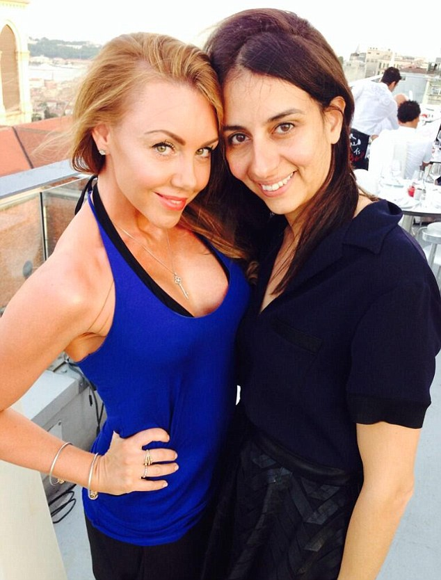 Toned up: Showing off her impressive gym physique, Michelle flashed her arms in a halter top with artistic director Inanch Emir