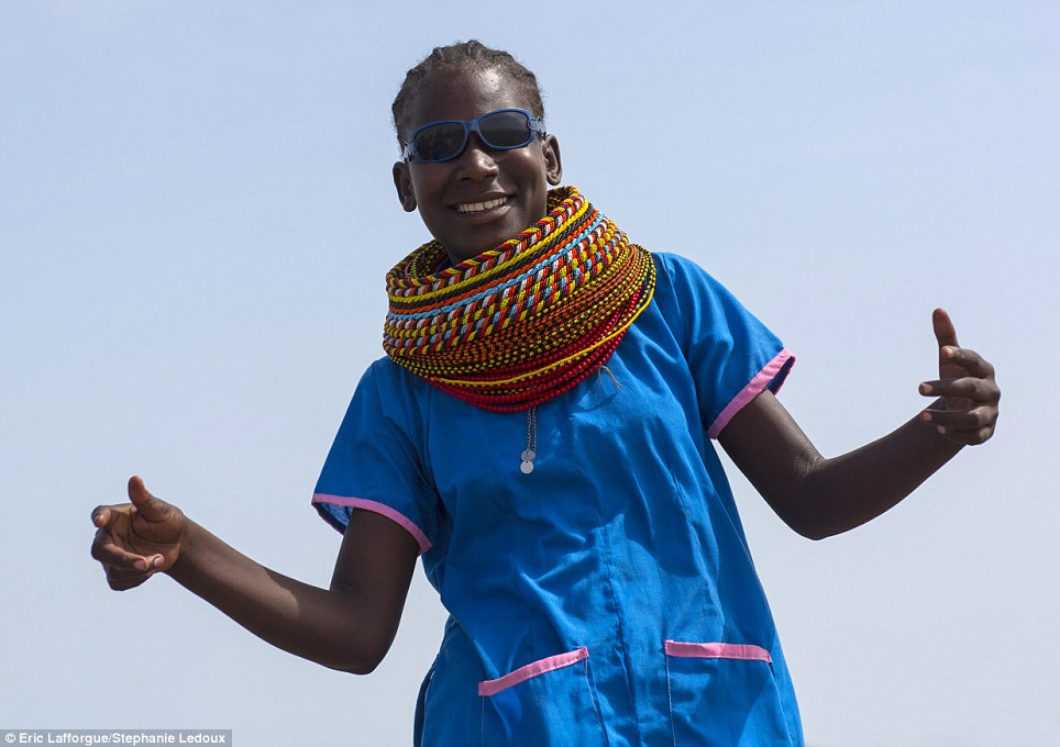 Modern: 16-year-old Elizabeth is one of the few Samburu to go to school and as a result, she has ditched most items of traditional dress with the exception of her collar