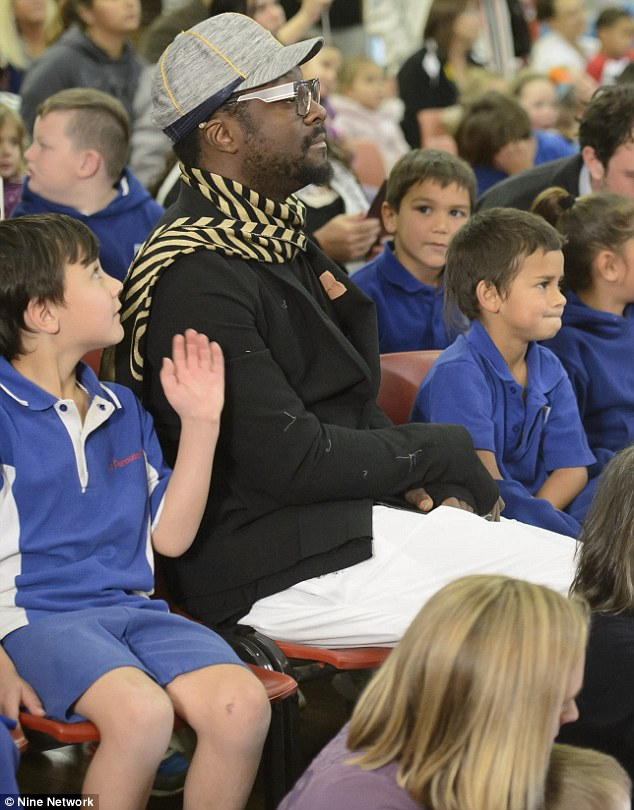 Front row ready: It looks like will.i.am showed his softer side as he positioned himself front row among the student body at a special assembly