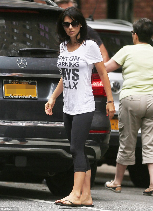 Casual: The fit mum was seen on July 10 preparing to leave town with hubby Alec and baby Carmen on tow