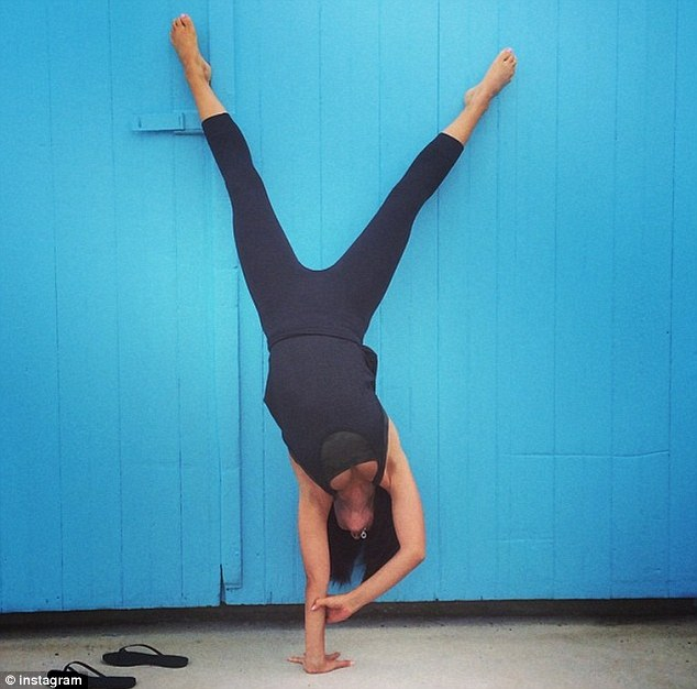 'How do you know if you don't try?': The mother-of-one posted this difficult one-handed handstand pose on Thursday