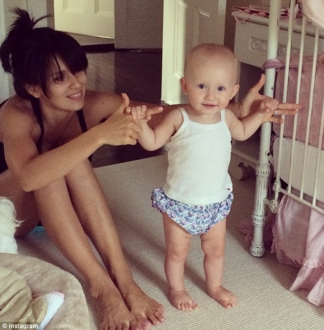 Adorable: On Thursday the 30-year-old mum posted a cute snap of daughter Carmen as it appears the tot can now walk