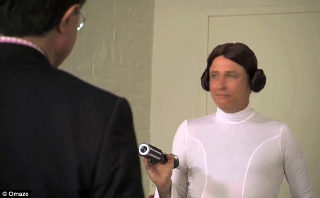Game, set and match: Jon tucks his light sabre under his arm as Stephen concedes defeat in admiration as his colleague's willingness to made a total idiot of himself by wearing the Princess Leia costume