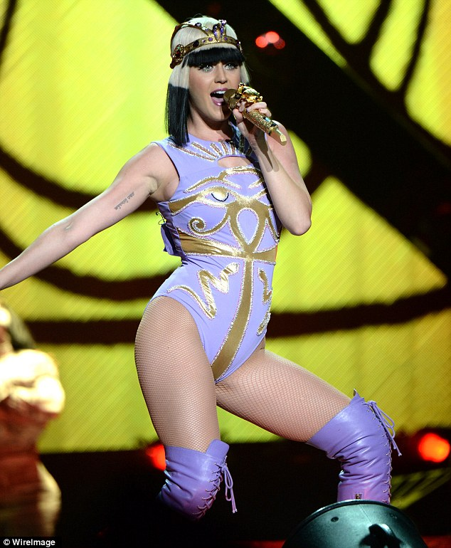 Prismatic World Tour: Earlier in July the Roar singer sported a purple and gold Egyptian-inspired leotard with knee-high purple boots, a blonde and black wig and gold headdress during a live performance
