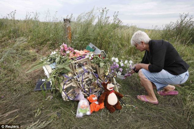Tributes: Locals have come out in their droves to leave flowers and tributes to the dead among the flowers as the investigation continues