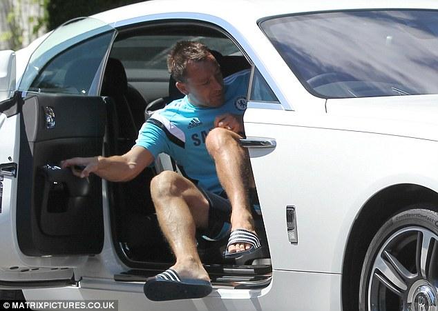 Terry clambers in to his £235,000 Rolls-Royce using the rear-hinge 'suicide' door