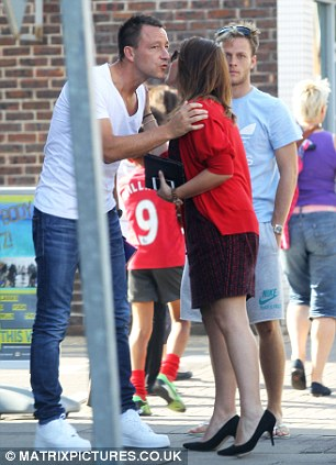 Chelsea Captain and former England footballer John Terry is seen greeting female fans on the local high street in Surrey
