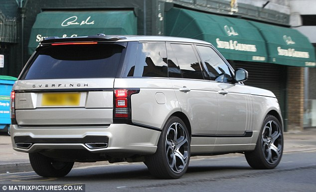 Terry  was seen drivinghis new special edition gold Range Rover Overfinch 4x4