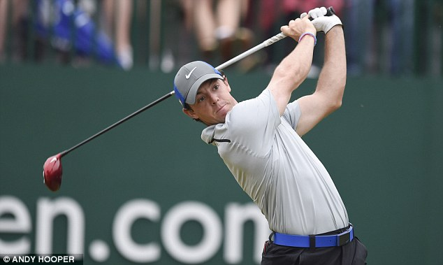 In the swing of things: Rory McIlroy, in action on day three, was the leader after the first two days