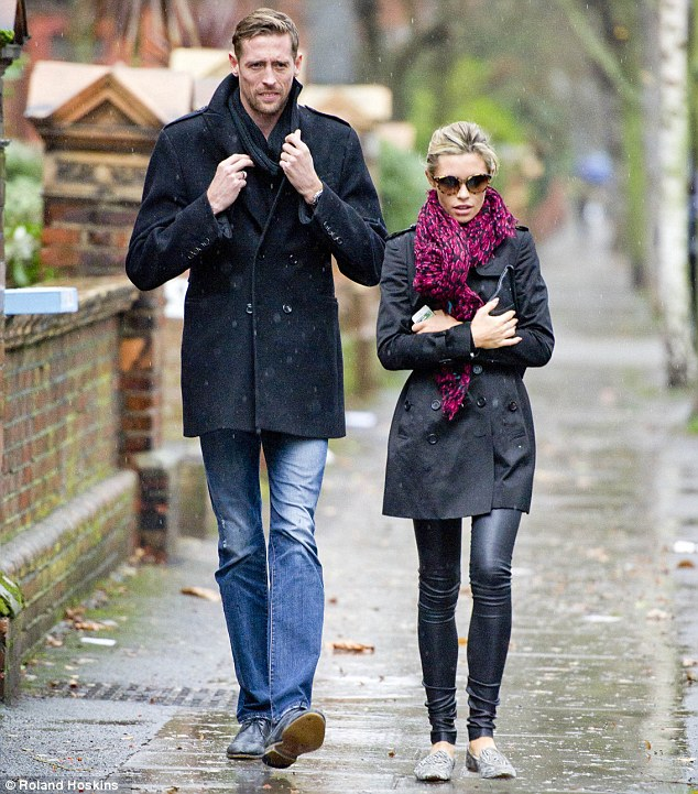 She's a model WAG: The pretty blonde is married to football star Peter Crouch, she revealed she doesn't mind being labelled a 'WAG'