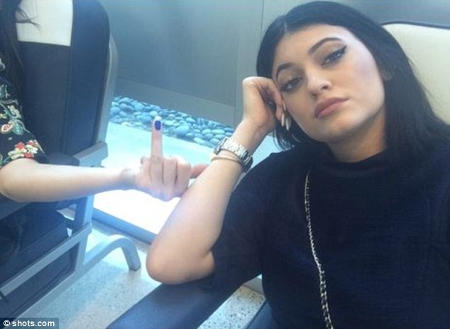 Fooled you! Kendall, 18, flips another bird but this time it's her ring finger