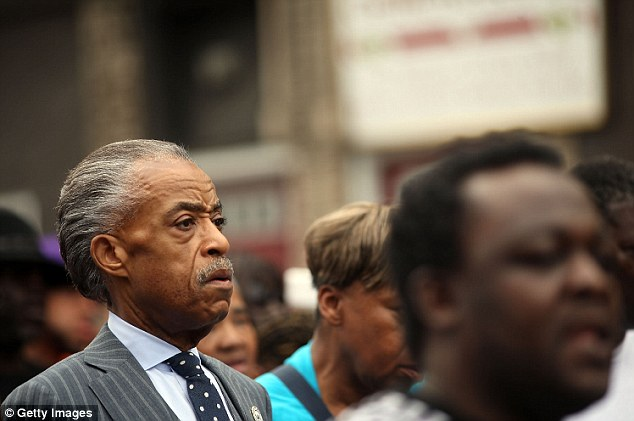 The Rev Al Sharpton marches with members of the Garner family on Saturday in memory of Eric, who died Thursday