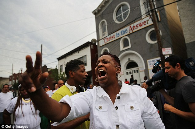 A rally is held to protest over Garner's death after police put him in a chokehold