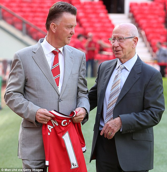 Unveliing: The new boss with club legend Sir Bobby Charlton at his arrival announcement