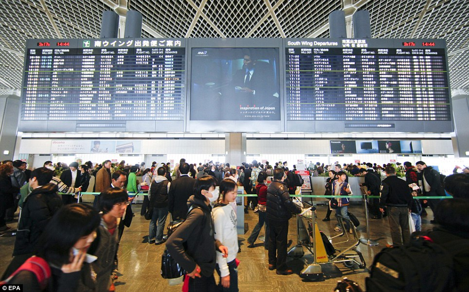 Busy terminal: Tokyo Narita has taken on new budget carriers but passengers often have to sleep in the terminal as local transport won't get them there for early flights