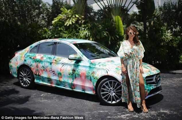 Import model? She posed next to vehicle with an exotic print, in a matching garment