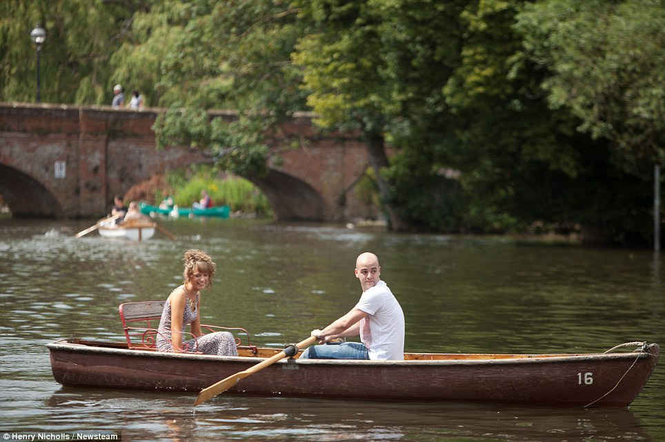 Jolly boating weather: A couple make the most of warm afternoon sun in Stratford-upon-Avon, Warwickshire
