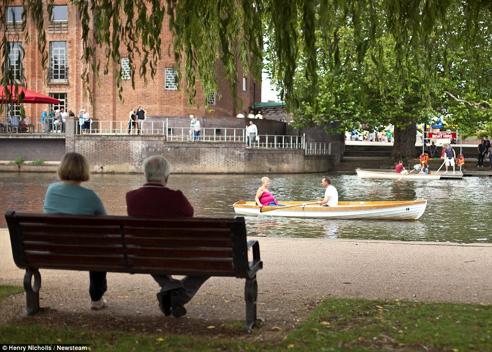 Calm: A man and woman relax as they watch scenes on the river in Stratford-upon-Avon, Warwickshire