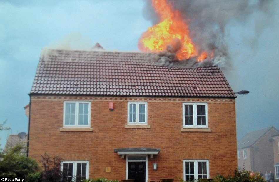 Blaze: Firefighters were called to the house in Laughton-en-le-Morthen, near Rotherham, South Yorkshire, just before 6pm yesterday