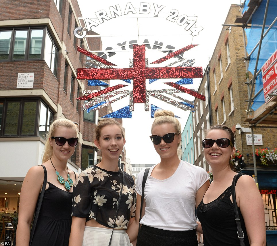 Al fresco dining: Members of the public enjoy the Carnaby St Eat, a one-day international food festival in Carnaby Street, central London