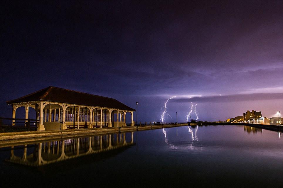 Purple sky: Another astonishing photograph of the lightning storm last night in Sheringham, Norfolk