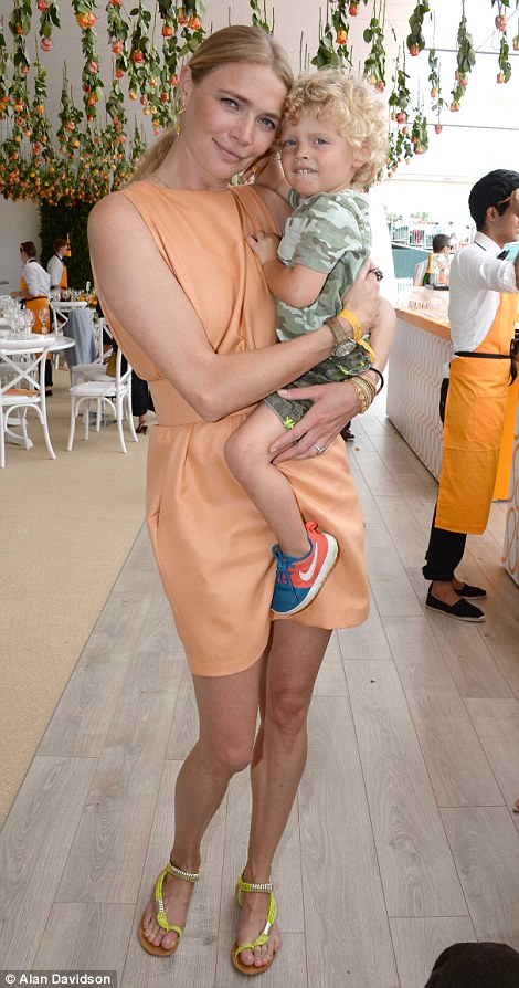 Jodie Kidd with her two-year-old son Indio at the Veuve Clicquot Gold Cup at Cowdray Park Polo Club in Midhurst, West Sussex